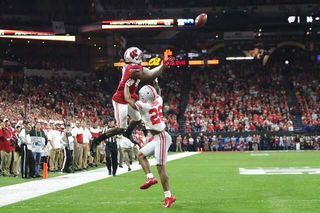 Wisconsin wide receiver Quintez Cephus (87) makes a catch against Ohio State cornerback Cameron Brown (26) during the first half of the Big Ten championship NCAA college football game Saturday, Dec. 7, 2019, in Indianapolis. (AP Photo/AJ Mast)