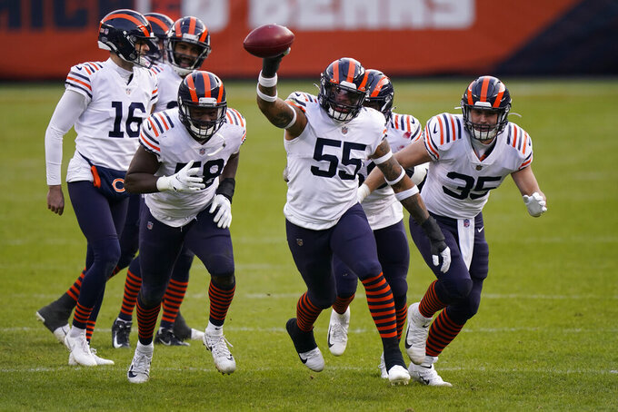 Chicago Bears' Josh Woods (55) celebrates a fumble recovery with teammates during the second half of an NFL football game against the Houston Texans, Sunday, Dec. 13, 2020, in Chicago. (AP Photo/Nam Y. Huh)