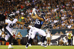 Tennessee Titans' Anthony Firkser, right, catches a touchdown pass as Philadelphia Eagles' L.J. Fort trails during the first half of a preseason NFL football game Thursday, Aug. 8, 2019, in Philadelphia. (AP Photo/Michael Perez)