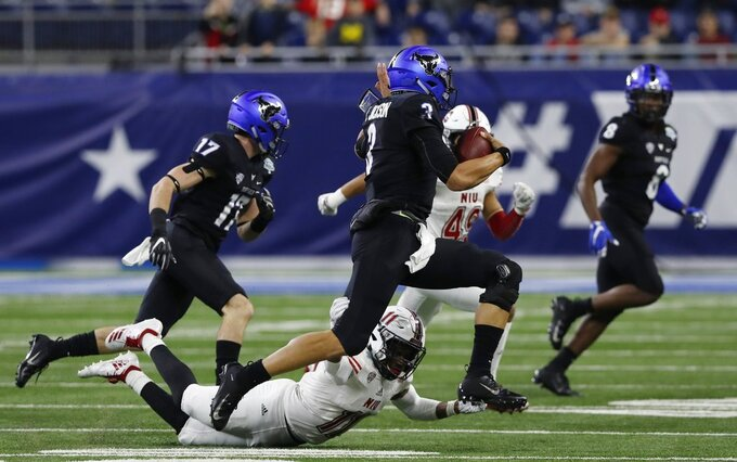 Buffalo quarterback Tyree Jackson (3) scrambles during the first half of the Mid-American Conference championship NCAA college football game against Northern Illinois, Friday, Nov. 30, 2018, in Detroit. (AP Photo/Carlos Osorio)