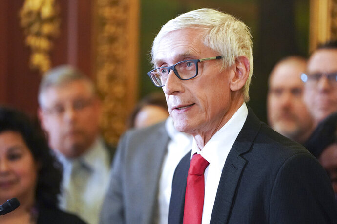 FILE - In this Feb. 6, 2020, file photo, Wisconsin Gov. Tony Evers holds a news conference in Madison, Wis. The conservative-controlled Wisconsin Supreme Court on Friday, July 10, 2020, overturned three of four partial budget vetoes issued by Democratic Gov. Tony Evers, bucking decades of court precedent that upheld the governor's broad veto powers. However, the justices also upheld one of Evers' vetoes and declined to consider a challenge to a pair of partial vetoes issued by Republican Gov. Scott Walker in 2017, saying the 2019 lawsuit was filed too late.(Steve Apps/Wisconsin State Journal via AP, File)