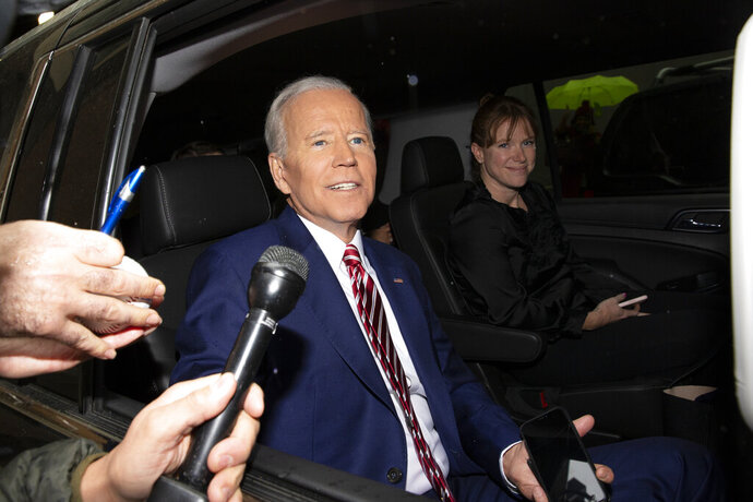 FILE - In this April 26, 2019 file photo, former Vice President and Democratic presidential candidate Joe Biden rides in a car after appearing on ABC's