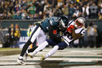 New England Patriots' Phillip Dorsett (13) hangs onto a touchdown pass against Philadelphia Eagles' Rasul Douglas (32) during the second half of an NFL football game against the Philadelphia Eagles, Sunday, Nov. 17, 2019, in Philadelphia. (AP Photo/Michael Perez)