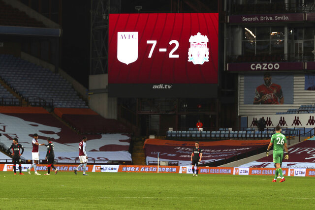 Liverpool players in dejection end of the English Premier League soccer match between Aston Villa and Liverpool at the Villa Park stadium in Birmingham, England, Sunday, Oct. 4, 2020. Aston Villa won 7-2. (Cath Ivill/Pool via AP)