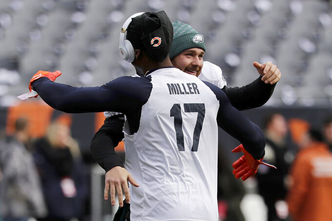 Chicago Bears wide receiver Anthony Miller and Philadelphia Eagles kicker Jake Elliott greet each other before an NFL wild-card playoff football game Sunday, Jan. 6, 2019, in Chicago. (AP Photo/Nam Y. Huh)