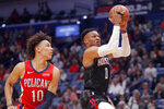 Houston Rockets guard Russell Westbrook (0) goes to the basket against New Orleans Pelicans center Jaxson Hayes (10) in the first half of an NBA basketball game in New Orleans, Monday, Nov. 11, 2019. (AP Photo/Gerald Herbert)
