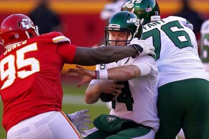 Kansas City Chiefs defensive tackle Chris Jones (95) pressures as New York Jets quarterback Sam Darnold (14) fights out of Jones' grasp in the second half of an NFL football game on Sunday, Nov. 1, 2020, in Kansas City, Mo. (AP Photo/Charlie Riedel)