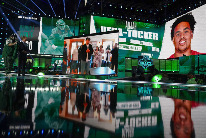 An image of Southern California's Alijah Vera-Tucker is on a screen after he was chosen by the New York Jets with the 14th pick in the first round of the NFL football draft, Thursday, April 29, 2021, in Cleveland. (AP Photo/Tony Dejak)