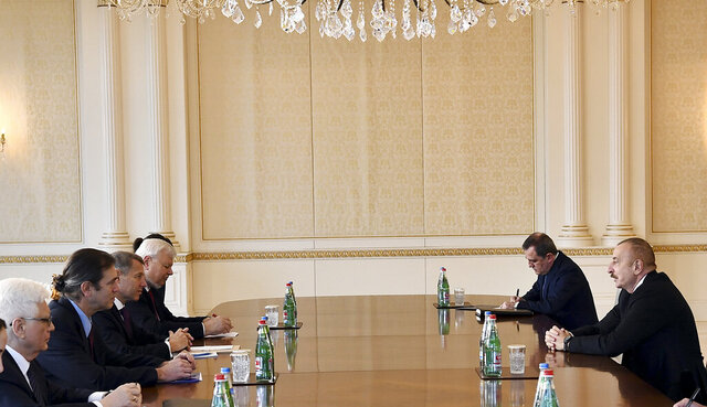 In this photo provided on Saturday, Dec. 12, 2020, by the Azerbaijan's Presidential Press Office, Azerbaijani President Ilham Aliyev, right, speaks to members of the OSCE Minsk Group co-chairs Stephane Visconti of France, Andrew Schofer of the US, Russian Ambassador to Azerbaijan Mikhail Bocharnikov and Personal Representative of the OSCE Chairperson-in-Office Andrzej Kasprzyk in Baku, Azerbaijan. Armenian officials on Saturday accused Azerbaijan of breaching a peace deal that ended six weeks of fierce fighting over Nagorno-Karabakh. Separatist officials in Nagorno-Karabakh said the Azerbaijani military launched an attack late Friday that left three local ethnic Armenian servicemen wounded. (Azerbaijani Presidential Press Office via AP)