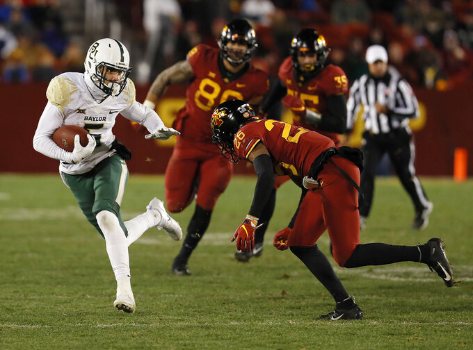 Baylor wide receiver Jalen Hurd, left, tries to elude Iowa State defensive back Anthony Johnson, right, during the second half of an NCAA college football game Saturday, Nov. 10, 2018, in Ames, Iowa. Iowa State won 28-14. (AP Photo/Matthew Putney)