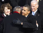 FILE - In this Jan. 20, 2009, file photo President Barack Obama embraces civil rights icon the Rev. Joseph E. Lowery during Obama's inauguration in Washington, as Sen. Dianne Feinstein, left, D-Calif., and Vice President Joe Biden watch. Lowery, a veteran civil rights leader who helped the Rev. Dr. Martin Luther King Jr. found the Southern Christian Leadership Conference and fought against racial discrimination, died Friday, March 27, 2020, a family statement said. He was 98. (Jim Bourg/Pool Photo via AP, File)