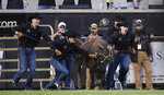 Handlers lead Colorado mascot Ralphie VI out of her pen for the traditional run before an NCAA college football game against Northern Colorado, Friday, Sept. 3, 2021, in Boulder, Colo. The run was the first for Ralphie VI, who was making her first appearance at a game. (AP Photo/David Zalubowski)
