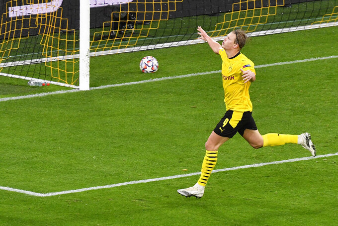 Dortmund's Erling Haaland celebrates after scoring his side's second goal during the Champions League group F soccer match between Borussia Dortmund and Zenit Saint Petersburg in Dortmund, Germany, Wednesday, Oct. 28, 2020. (AP Photo/Martin Meissner, Pool)