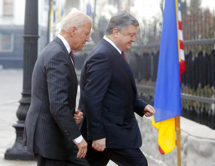 """FILE - In this Jan. 16, 2017, file photo Vice President Joe Biden, left, and Ukrainian President Petro Poroshenko go for talks during Biden's visit in Kiev, Ukraine. The leaked recordings of apparent conversations between Joe Biden and Ukraine's then-president largely confirm Biden's account of his dealings in Ukraine. The choppy audio, disclosed by a Ukrainian lawmaker whom U.S. officials described Thursday, Sept. 10, 2020, as an """"active Russian agent"""" who has sought to spread online misinformation about Biden. (AP Photo/Efrem Lukatsky, File)"""