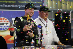 Kurt Busch, left, and team owner Chip Ganassi, right, celebrate after announcing a multi-year contract for Busch with Ganassi racing during a NASCAR news conference at Texas Motor Speedway in Fort Worth, Texas, Saturday, Nov. 2, 2019. (AP Photo/Roger Steinman)