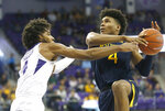 West Virginia guard Miles McBride (4) drives inside as TCU guard PJ Fuller (4) defends during the first half of an NCAA college basketball game, Saturday, Feb. 22, 2020 in Fort Worth, Texas. (AP Photo/Ron Jenkins)