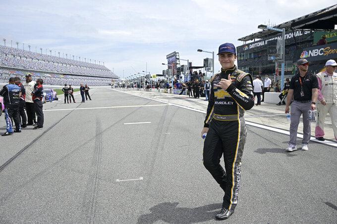 Driver Sam Mayer walks to his vehicle on pit road before a NASCAR Xfinity Series auto race at Daytona International Speedway, Saturday, Aug. 28, 2021, in Daytona Beach, Fla. (AP Photo/Phelan M. Ebenhack)