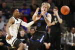 Vanderbilt's Saben Lee (0) knocks the ball away from Tulsa guard Lawson Korita (5) during the first half of an NCAA college basketball game Saturday, Nov. 30, 2019, in Nashville, Tenn. (AP Photo/Mark Humphrey)