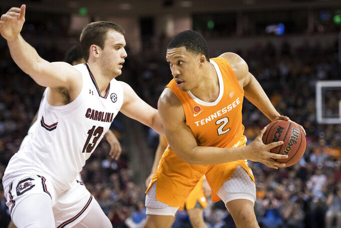 Tennessee forward Grant Williams (2) makes a move on South Carolina forward Felipe Haase (13) during the second half of an NCAA college basketball game Tuesday, Jan. 29, 2019, in Columbia, S.C. Tennessee defeated South Carolina 92-70. (AP Photo/Sean Rayford)