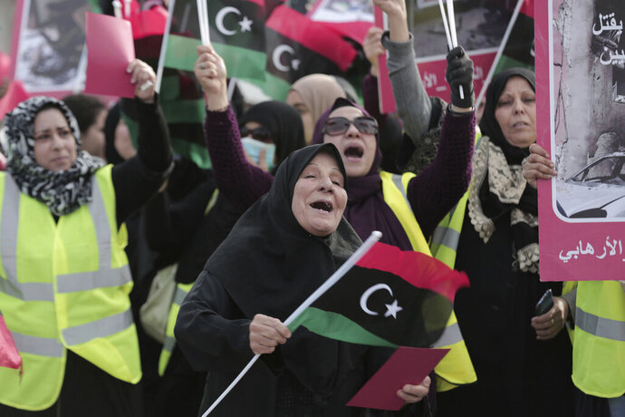 Women take part in a protest in Tripoli, Libya as they wave national flags and chant slogans against Libya's Field Marshal Khalifa Hifter, who is leading an offensive to take over the capital of Tripoli, Friday, April 19, 2019. (AP Photo/Hazem Ahmed)