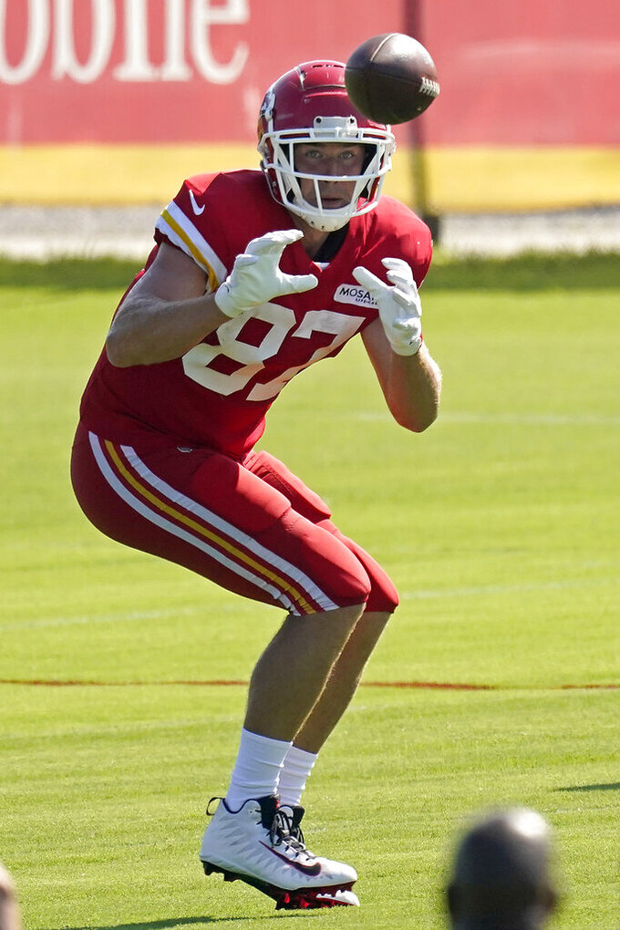 Kansas City Chiefs tight end Travis Kelce catches a pass at NFL football training camp Tuesday, Aug. 17, 2021, in St. Joseph, Mo. (AP Photo/Charlie Riedel)