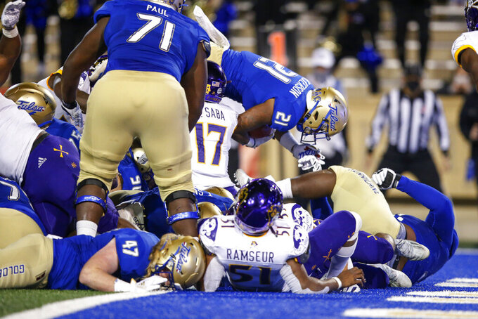 Tulsa running back TK Wilkerson (21) leaps into the end zone for the go-ahead touchdown with under a minute left during an NCAA college football game Friday, Oct. 30, 2020, in Tulsa, Okla. (Ian Maule/Tulsa World via AP)