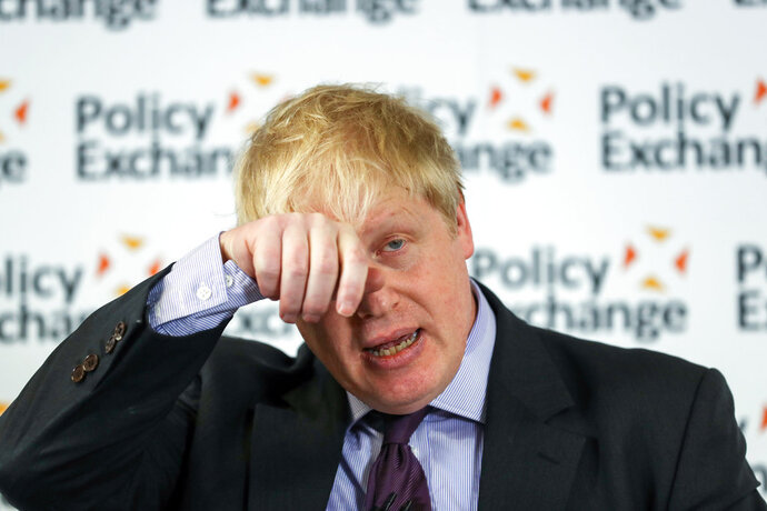 Britain's Foreign Secretary Boris Johnson wipes his forehead as he delivers a speech at the Policy Exchange in London, Wednesday Feb. 14, 2018. The Foreign Office says Johnson will use a speech Wednesday to argue for