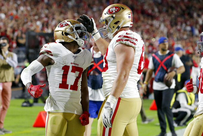 San Francisco 49ers wide receiver Emmanuel Sanders (17) celebrates his touchdown against the Arizona Cardinals with offensive tackle Daniel Brunskill during the first half of an NFL football game, Thursday, Oct. 31, 2019, in Glendale, Ariz. (AP Photo/Rick Scuteri)