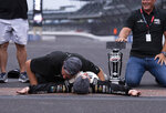 """Kaulig Racing president Chris Rice, top, celebrates the victory with driver AJ Allmendinger, bottom, at the """"yard of bricks"""" after winning a NASCAR Cup Series auto race at Indianapolis Motor Speedway, Sunday, Aug. 15, 2021, in Indianapolis. (AP Photo/Doug McSchooler)"""