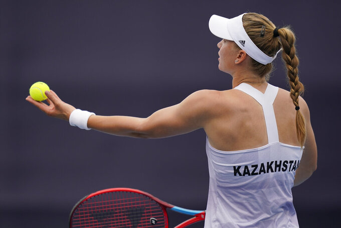 Elena Rybakina, of Kazakhstan, serves to Rebecca Peterson, of Sweden, during the second round of the tennis competition at the 2020 Summer Olympics, Monday, July 26, 2021, in Tokyo, Japan. (AP Photo/Seth Wenig)