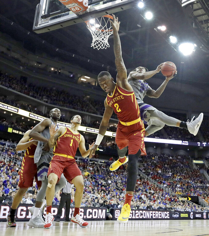 Kansas State's Cartier Diarra (2) shoots over Iowa State's Cameron Lard (2) during the second half of an NCAA college basketball game in the Big 12 men's tournament Friday, March 15, 2019, in Kansas City, Mo. Iowa State won 63-59. (AP Photo/Charlie Riedel)