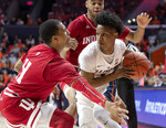 Illinois guard Trent Frazier (1) looks for room to pass under pressure from Indiana guard Devonte Green (11) and forward Juwan Morgan during the first half of an NCAA college basketball game in Champaign, Ill., Thursday, March 7, 2019. (AP Photo/Stephen Haas)