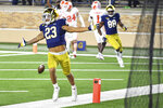 Notre Dame  running back Kyren Williams (23) celebrates after his first-quarter touchdown against Clemson during an NCAA college football game Saturday, Nov. 7, 2020, in South Bend, Ind. (Matt Cashore/Pool Photo via AP)