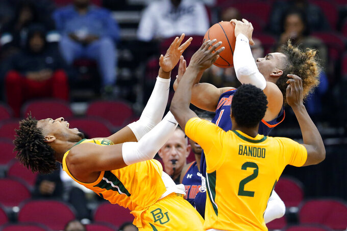 Baylor forward Freddie Gillespie, reacts as he is knocked back during the shot attempt by Tennessee-Martin guard Parker Stewart (1) as guard Devonte Bandoo (2) defends during the first half of an NCAA college basketball game Wednesday, Dec. 18, 2019, in Houston. (AP Photo/Michael Wyke)