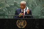 Maldives President Ibrahim Mohamed Solih takes off his mask to address the 76th Session of the United Nations General Assembly at U.N. headquarters in New York on Tuesday, Sept. 21, 2021.   (Eduardo Munoz/Pool Photo via AP)