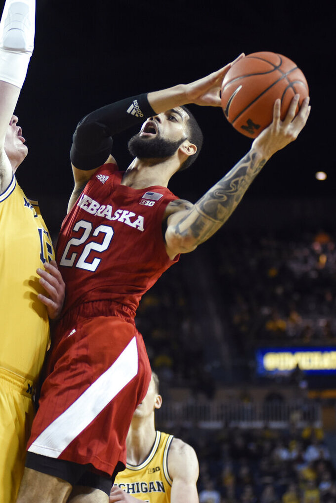 Nebraska guard Haanif Cheatham shoots over Michigan center Jon Teske during the first half of an NCAA college basketball game Thursday, March 5, 2020, in Ann Arbor, Mich. (AP Photo/Jose Juarez)
