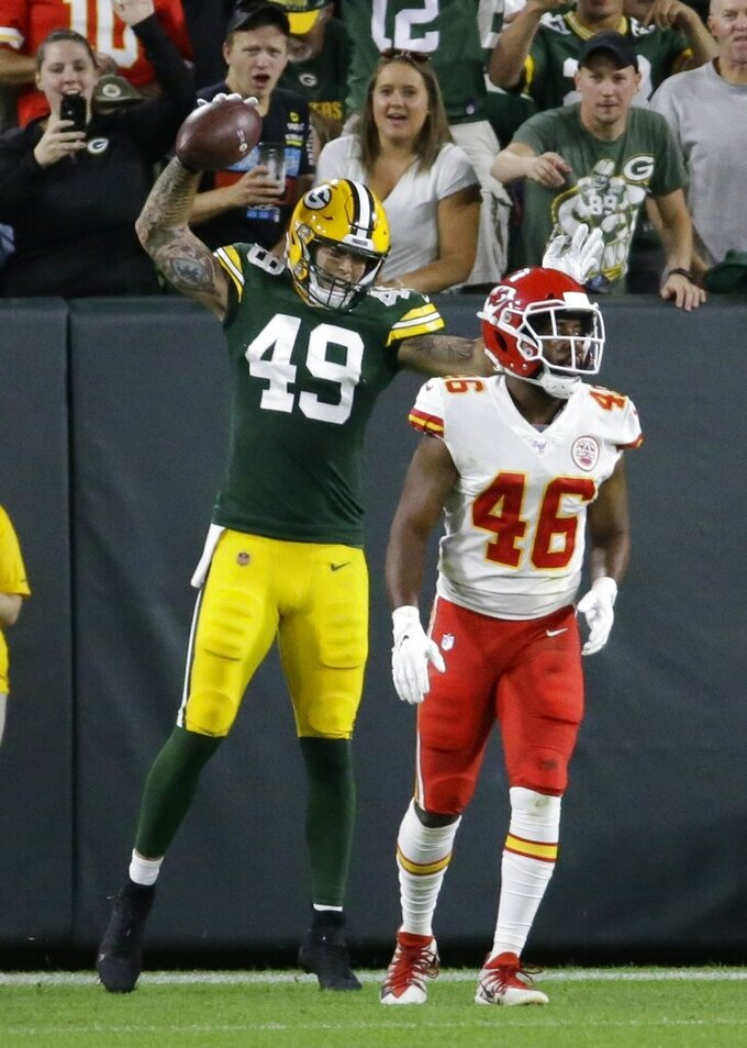 Green Bay Packers' Evan Baylis celebrates his touchdown catch during the first half of a preseason NFL football game against the Kansas City Chiefs Thursday, Aug. 29, 2019, in Green Bay, Wis. (AP Photo/Mike Roemer)