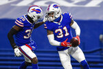 Buffalo Bills cornerback Levi Wallace, left, celebrates with teammate Dean Marlowe (31) after Marlowe recovered a fumble by New England Patriots quarterback Cam Newton during the second half of an NFL football game Sunday, Nov. 1, 2020, in Orchard Park, N.Y. The Bills won 24-21. (AP Photo/Adrian Kraus)