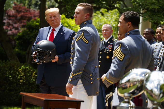President Donald Trump looks on as Army linebacker Cole Christiansen speaks during the presentation of the Commander-in-Chief's Trophy to the U.S. Military Academy at West Point football team, in the Rose Garden of the White House, Monday, May 6, 2019, in Washington. (AP Photo/Evan Vucci)