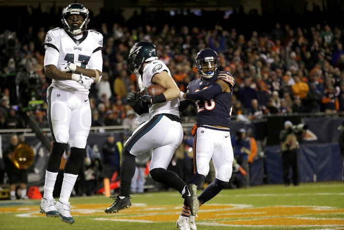 Philadelphia Eagles wide receiver Alshon Jeffery (17) celebrates as tight end Dallas Goedert makes a touchdown catch during the second half of an NFL wild-card playoff football game against the Chicago Bears Sunday, Jan. 6, 2019, in Chicago. At right is Chicago Bears safety Deon Bush. (AP Photo/Nam Y. Huh)