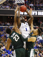 Duke forward Zion Williamson (1) drives under basket to score on on Michigan State forward Xavier Tillman (23) and forward Kenny Goins (25) during the second half of an NCAA men's East Regional final college basketball game in Washington, Sunday, March 31, 2019. (AP Photo/Alex Brandon)