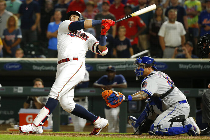 Minnesota Twins designated hitter Nelson Cruz fouls out with the bases loaded and a full count during the ninth inning of the team's baseball game against the New York Mets on Tuesday, July 16, 2019, in Minneapolis. The Mets won 3-2. (AP Photo/Bruce Kluckhohn)