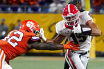 Georgia tight end Brock Bowers, right, pushes off Clemson linebacker LaVonta Bentley during the first half of an NCAA college football game Saturday, Sept. 4, 2021, in Charlotte, N.C. (AP Photo/Chris Carlson)