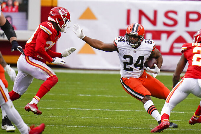 Cleveland Browns running back Nick Chubb (24) runs from Kansas City Chiefs safety L'Jarius Sneed, left, during the first half of an NFL divisional round football game, Sunday, Jan. 17, 2021, in Kansas City. (AP Photo/Jeff Roberson)