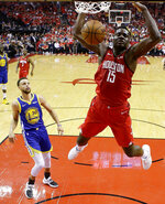 Houston Rockets center Clint Capela (15) dunks as Golden State Warriors guard Stephen Curry (30) watches during the first half of Game 3 of a second-round NBA basketball playoff series, Saturday, May 4, 2019, in Houston. (AP Photo/Eric Christian Smith)