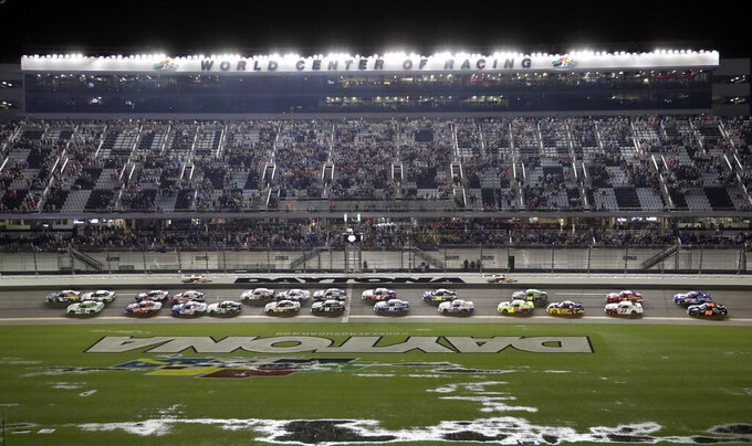 Tyler Reddick (2) and A J Allmendinger (10) lead the field to start the NASCAR Xfinity Series auto race at Daytona International Speedway, Friday, July 5, 2019, in Daytona Beach, Fla. (AP Photo/John Raoux)