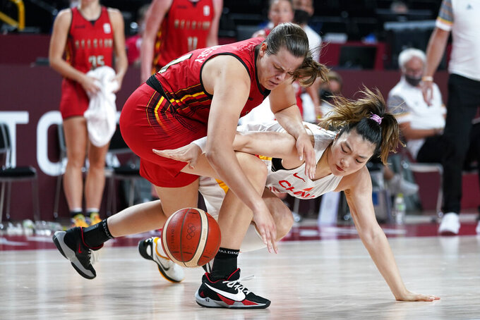 Belgium's Billie Massey fights for a loose ball with China's Meng Li, right, during a women's basketball preliminary round game at the 2020 Summer Olympics, Monday, Aug. 2, 2021, in Saitama, Japan. (AP Photo/Charlie Neibergall)