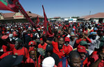 Members of the Economic Freedom Fighters protest outside the magistrates court in Senekal, South Africa, Friday, Oct. 16, 2020 where two suspects were to appear on charges of killing a white farmer in the area. The killing of a white farmer allegedly by two black men in South Africa has stoked racial tensions and threatened to ignite violence between racial groups in the Free State province. It has also highlighted concerns about the government's inability to deal with crime in general and killings in the country's rural and farming communities. (AP Photo/Themba Hadebe)