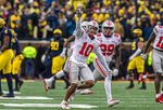Ohio State cornerback Amir Riep (10) celebrates his interception of a Michigan pass with safety Marcus Hooker (29) in the fourth quarter of an NCAA college football game in Ann Arbor, Mich., Saturday, Nov. 30, 2019. Ohio State won 56-27. (AP Photo/Tony Ding)