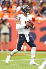 Chicago Bears quarterback Mitchell Trubisky (10) looks downfield for a receiver in an NFL game against the Denver Broncos, Sunday Sept. 15, 2019, in Denver. The Bears defeated the Broncos 16-14. (Margaret Bowles via AP)